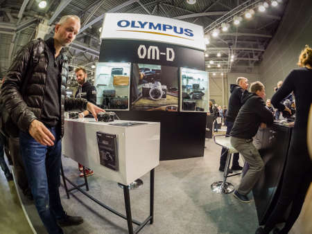 MOSCOW, RUSSIA - APRIL 13, 2018: Booth of Olympus company at PhotoForum 2017 trade show and exhibition in Moscow, Russia on April 13, 2018.