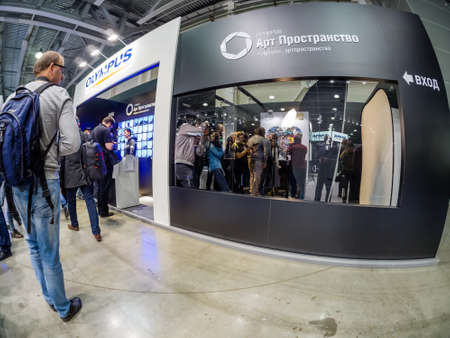 MOSCOW, RUSSIA - APRIL 13, 2018: Art Space booth of Olympus company at PhotoForum 2018 trade show and exhibition in Moscow, Russia on April 21, 13, 2018.