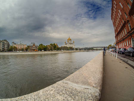 MOSCOW, RUSSIA - SEPTEMBER 11, 2018: Cathedral of Christ the Saviour and Moskva River embankment in Moscow, Russia on September 11, 2018.