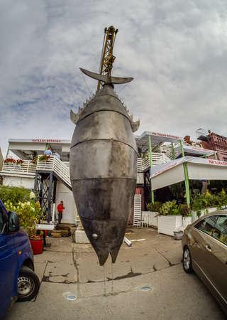 MOSCOW, RUSSIA - SEPTEMBER 11, 2018: Metal Tunny Fish sculpture hanged on lift crane near Magadan Veranda restaurant in Moscow, Russia on September 11, 2018. Editorial