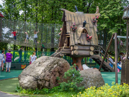 MOSCOW, RUSSIA - JULY 26, 2018: Unidentified people look at  fairytale hut on chicken legs in childrens amusement park Lukomorye in Moscow, Russia on July 26, 2018. Editorial