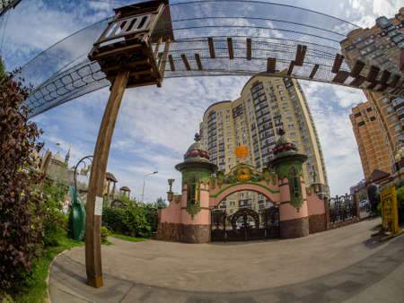 MOSCOW, RUSSIA - JULY 26, 2018: Entrance gate to childrens amusement park Lukomorye with extreme rope ladder way and safety net in Moscow, Russia on July 26, 2018.