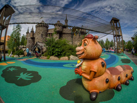 MOSCOW, RUSSIA - JULY 26, 2018: Unidentified people visit fairytale castle with extreme rope ladder  way and safety net in childrens amusement park Lukomorye in Moscow, Russia on July 26, 2018.