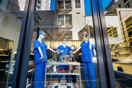 SAN FRANCISCO, US - OCT 1, 2012: Dummies of people wearing blue medical gowns, goggles, gloves and protective masks stand in a shop window of a leather repair shop on Oct 1, 2012 in San Francisco, US.
