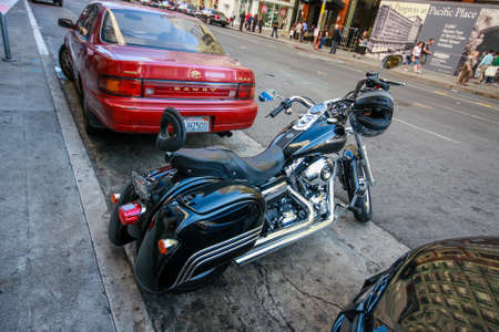 SAN FRANCISCO, USA - SEPT 30, 2012: Black Harley Davidson Super Glide motorcycle with helmet on the handlebar stays in the parking lot on the street on Sept 30, 2012 in San Francisco, USA.