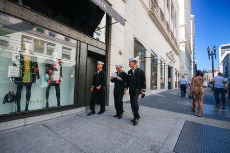 SAN FRANCISCO, USA - OCT 1, 2012: Three US Navy sailors on leave in dark uniform walk down the street on Oct 1, 2012 in San Francisco, USA. Editorial