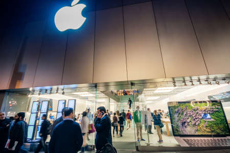 SAN FRANCISCO, USA - OCT 3, 2012: People meet at the entrance to the Apple Store in the evening before shopping on Oct 3, 2012 in San Francisco, USA.