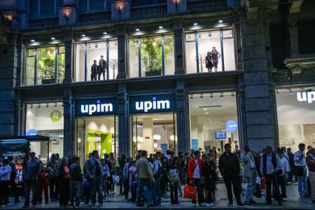 MILAN, ITALY - SEPT 14, 2008: People enter in the evening the Upim store specializing in the sale of clothing and cosmetics in Milan on Sept 14, 2008.
