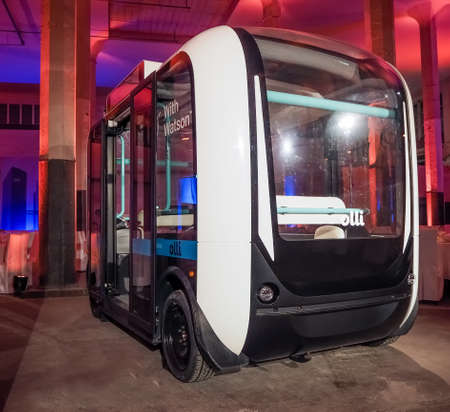 MUNICH, GERMANY - FEBRUARY 16, 2017: IBM demonstrates self-driving bus Olli equipped with Watson artificial intelligence technology at Genius of Things Summit in Munich, Germany on February 16, 2017.