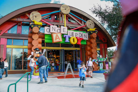 ORLANDO, FLORIDA - JANUARY 19, 2009: People go to entrance of Once Upone a Toy shop in Downtown Disney in Orlando, Florida on January 19, 2009.