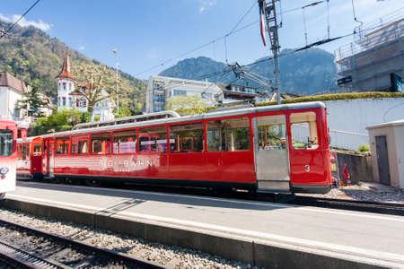 VITZNAU, SWITZERLAND - APRIL 20, 2014:  Railway station for trip from lake Lucerne shore to mount Rigi in Vitznau on April 20, 2014. Rigi railway is the Europe's oldest mountain railways
