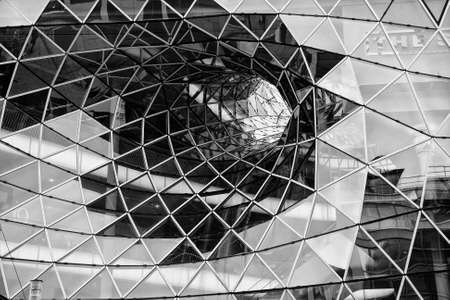 Faceted glass diminishing funnel as architectural stucture of modern building