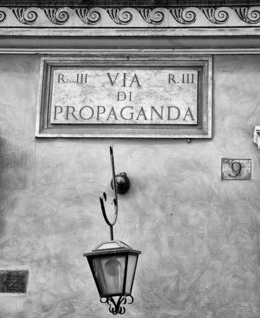 Symbolic street sign Propaganda on painted stucco wall