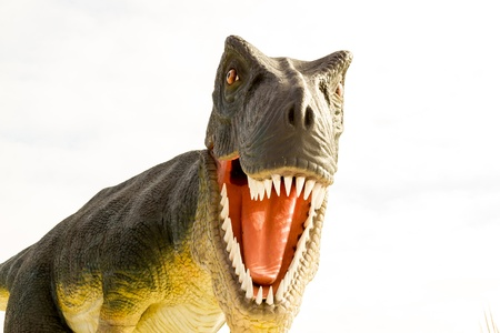 Dinosaur attack. Closeup view of an opened-mouth dinosaur.  Stock Photo