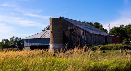 abandoned farmhouse abandoned farmhouse: An old abandoned farmhouse and prairie grasses. Stock Photo