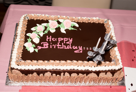 sweetest: Birthday cake in chocolate flavour with the words happy birthday.