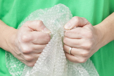 obsessive: Man holding bubble wrap, stress relief
