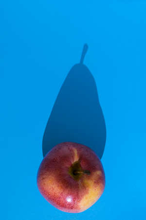 Conceptual image of a fruit that through its shadow shows its true personality