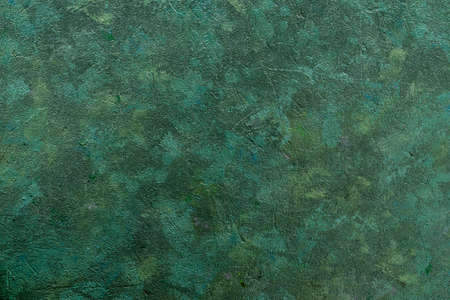 Abstract grunge rough uneven decorative background. Green tones background art texture with copy space.