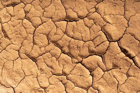 Dry cracked clay texture. Consequences of global warming. Ravages of climate change.