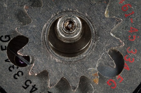 clarified: clockwork gears from iron-based, with the numbers of the month and time ruby macro close-up shot clarified ..