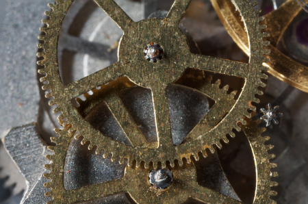 clockwork gears from iron-based, macro close-up shot with dimming.