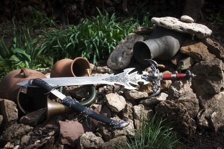cold steel: Photo of cold steel against the background of natural stones. Stock Photo