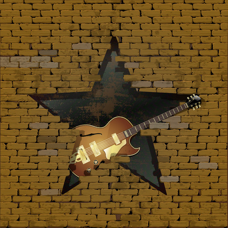 jazz guitar electric guitar in the gap in the form of a star of the old brick wall.