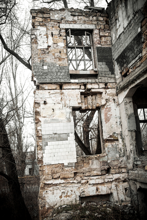 window opening: Ukraine, Odessa area destroyed factory. Ruins of the destroyed building or premises. Window opening and ventilator. Stock Photo