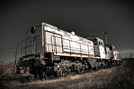 Old rusty locomotive train on an unfinished nuclear power plant in Ukraine, Odessa region.