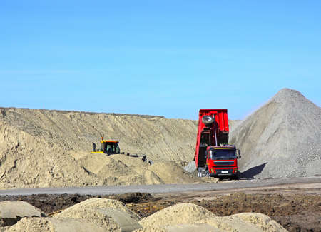 Dump truck and bulldozer working on road construction photo