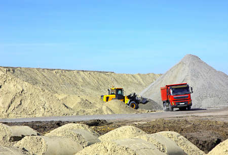 Dump truck and bulldozer working on road construction