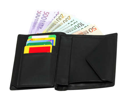 Opened black leather wallet with credit cards and banknotes photo