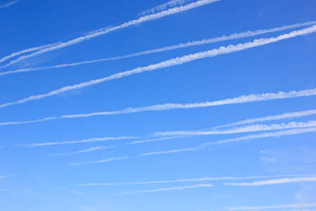 ozone layer: Blue sky with many contrails Stock Photo