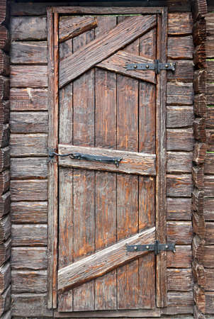 hinges: Stylized antique wooden door with wrought-iron hinges and hook