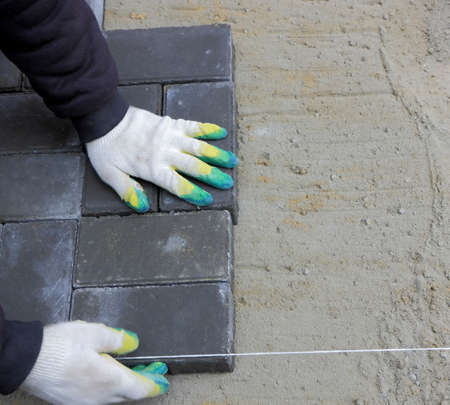 color photo: Installing paving slabs. Color photo close-up Stock Photo