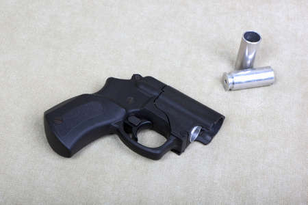 Tubeless doubly charged traumatic gun and two cartridges Stock Photo