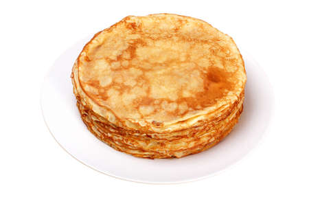 Stack of pancakes on white plate on mat of straw Stock Photo