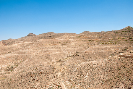 Destroyed long stone walls in the desert Stock Photo