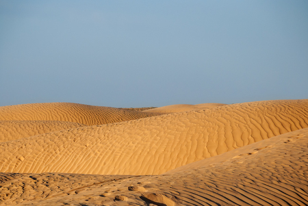 Embossed dunes in the desert at sunset or sunrise Stock Photo