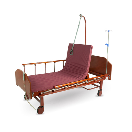 Modern automatic bed for a hospital for people with little mobility with a remote control isolated on a white background
