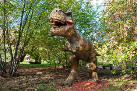 A huge prehistoric scary dinosaur stands in the attacking pose Stock Photo