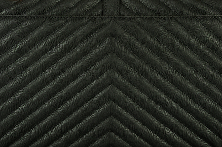 The texture of the skin is black with a prominent diagonal pattern