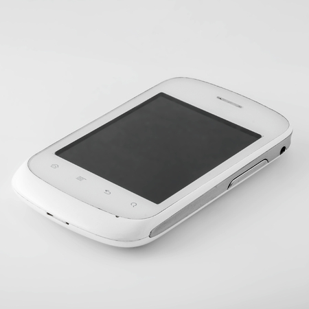A white smartphone with a blank black screen turned off lies on a white surface with a shadow. Stock fotó