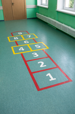 Grid with numbers for children's game, painted on the floor in the room
