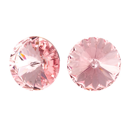 Large round pink crystal rhinestones. Front and side view. Isolated on white.
