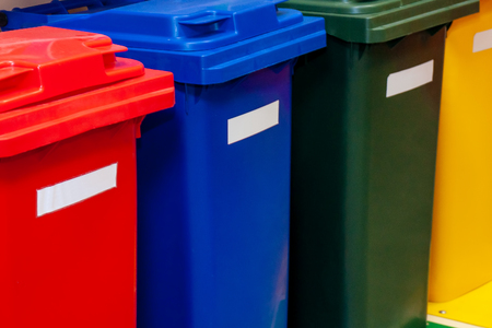 Plastic containers in four different colors for separate waste collection