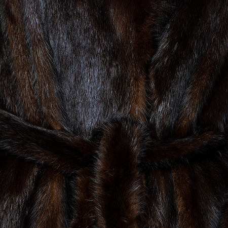 Texture natural spotted dark brown shiny fur with belt Stock fotó