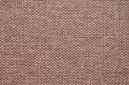 The texture of dark beige burlap. Natural background from woven coarse threads fabric Stock fotó