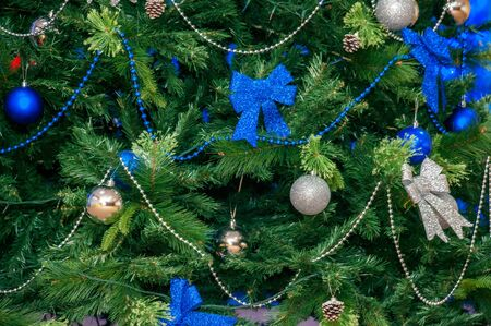 Decorated Christmas tree in blue-green tones close-up part